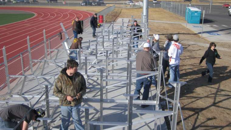 FC BOCES Green Construction students help construct new bleachers at Wolverine Field